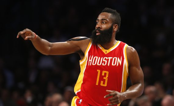 Houston Rockets' James Harden (13) runs the floor after scoring against the Brooklyn Nets during the third quarter of an NBA basketball game Monday, Jan. 12, 2015, in New York.  Houston beat Brooklyn 113-99. (AP Photo/Jason DeCrow)