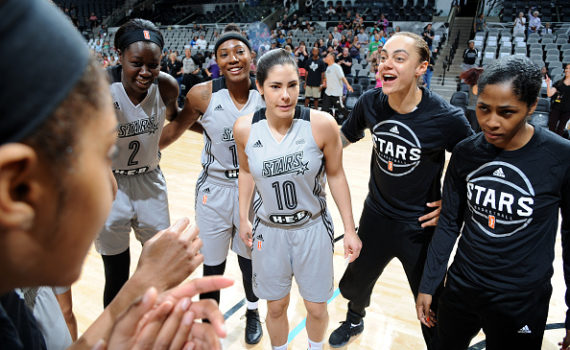 SAN ANTONIO, TX - APRIL 29: The San Antonio Stars huddle up around Kelsey Plum #10 of the San Antonio Stars before the game against the Dallas Wings during the WNBA Preseason on April 29, 2017 at the AT&T Center in San Antonio, Texas. NOTE TO USER: User expressly acknowledges and agrees that, by downloading and or using this photograph, user is consenting to the terms and conditions of the Getty Images License Agreement. Mandatory Copyright Notice: Copyright 2017 NBAE (Photos by Mark Sobhani/NBAE via Getty Images)