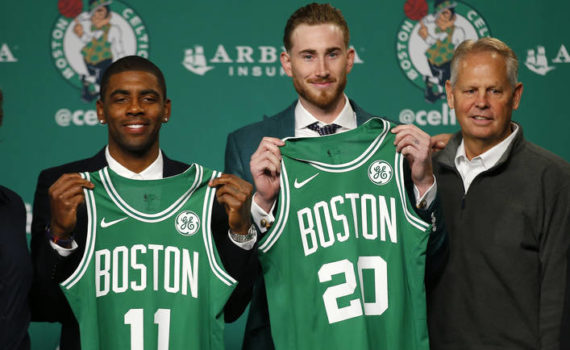 Boston Celtics' Kyrie Irving, left, and Gordon Hayward hold up their new jerseys with General Manager Danny Ainge, right, during a news conference in Boston, Friday, Sept. 1, 2017. (AP Photo/Winslow Townson)