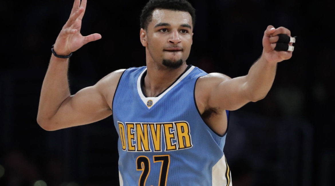Denver Nuggets' Jamal Murray gestures after making a three-point basket during the second half of an NBA preseason basketball game against the Los Angeles Lakers, Friday, Oct. 7, 2016, in Los Angeles. The Nuggets won 101-97. (AP Photo/Jae C. Hong)