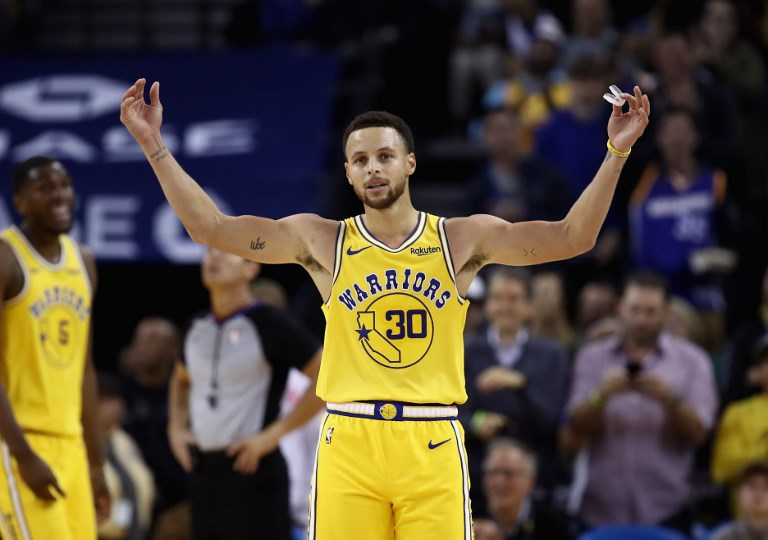 """OAKLAND, CA - OCTOBER 24: Stephen Curry #30 of the Golden State Warriors reacts to the crowd chanting """"MVP"""" during their game against the Washington Wizards at ORACLE Arena on October 24, 2018 in Oakland, California. Curry finished the game with 51 points. NOTE TO USER: User expressly acknowledges and agrees that, by downloading and or using this photograph, User is consenting to the terms and conditions of the Getty Images License Agreement.   Ezra Shaw/Getty Images/AFP"""