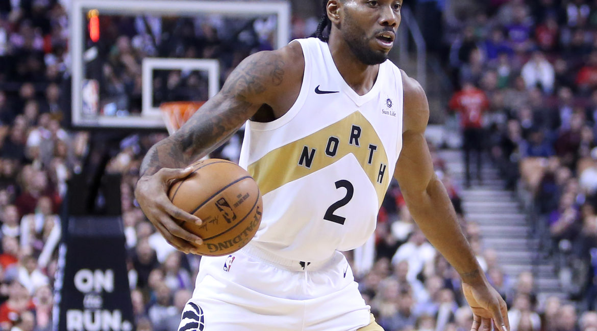 TORONTO, ON - NOVEMBER 23:  Kawhi Leonard #2 of the Toronto Raptors dribbles the ball during the second half of an NBA game against the Washington Wizards at Scotiabank Arena on November 23, 2018 in Toronto, Canada.  NOTE TO USER: User expressly acknowledges and agrees that, by downloading and or using this photograph, User is consenting to the terms and conditions of the Getty Images License Agreement.  (Photo by Vaughn Ridley/Getty Images)